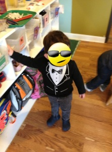 GQ toddler posing. Face covered to protect the innocent.