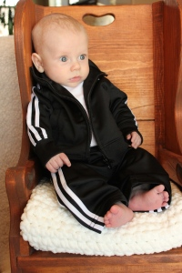 Adidas track suit (just like Daddy) from Auntie Nikki & Uncle Aaron Handmade rocking chair made by Great Grandpa Rabon