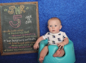 J with his 5 month chalkboard :)