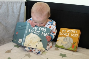 Very important morning reading in his crib :)